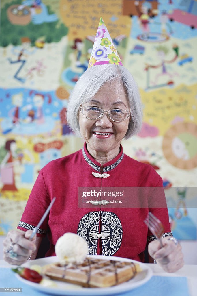 Woman at party with plate of waffles : Stock Photo