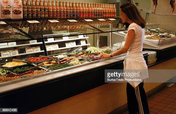 Woman at salad buffet