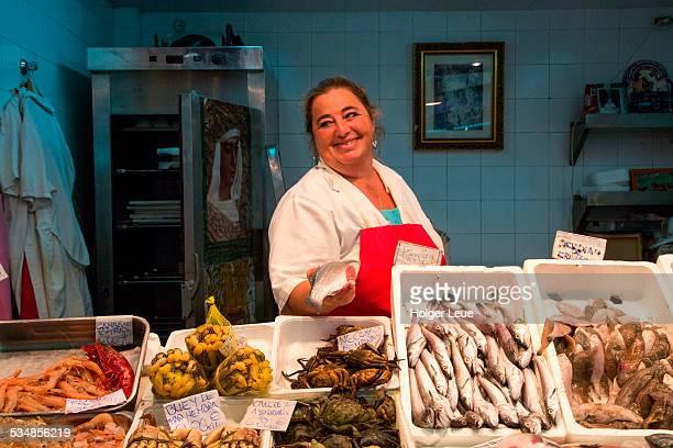 Woman at seafood shop at Mercado de Triana