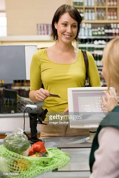 Woman at supermarket checkout