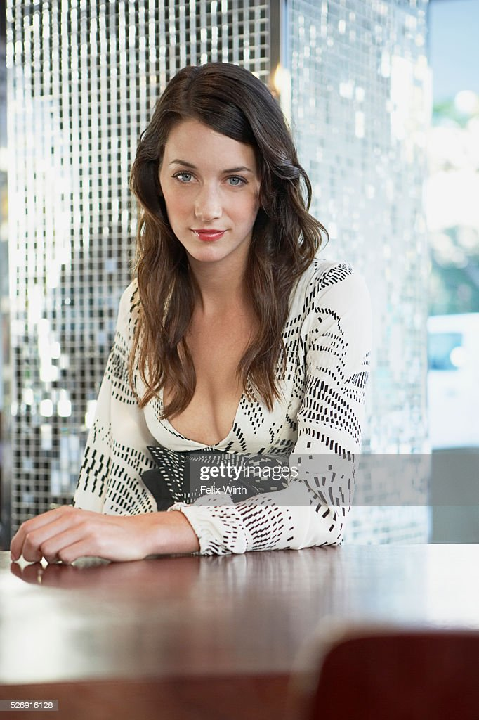 Woman at table : Stock Photo