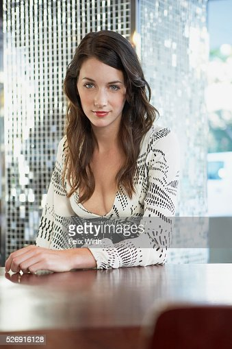 Woman at table : Stockfoto