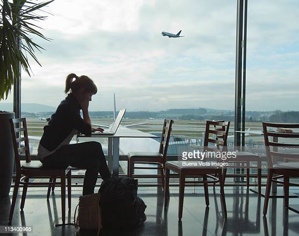 Woman at the airport waiting for a fly