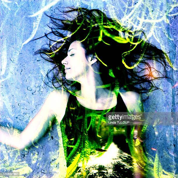 Woman at the aquarium in Paris France in 2008 Double exposure of a woman with seaweed
