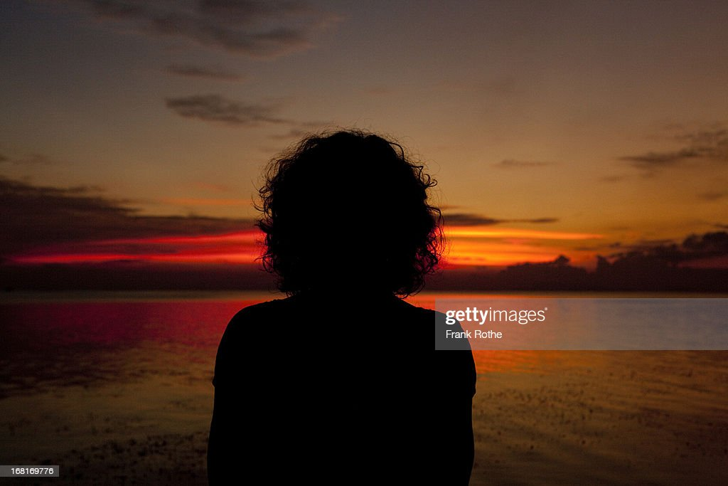 woman at the beach during sunset : Stock Photo