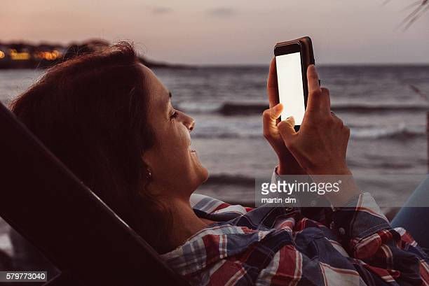 Woman at the beach texting