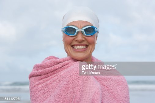 woman at the beach wrapped in a towel : Stock Photo