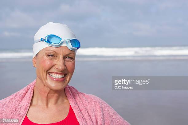 Woman at the beach wrapped in a towel
