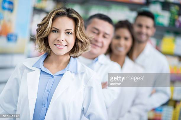 Woman at the drugstore with a group of pharmacists