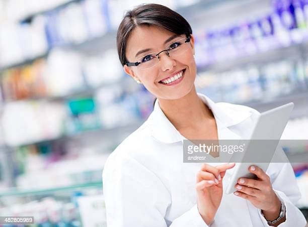 Woman at the drugstore with a tablet