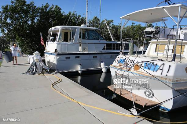 A woman at the Founders Park Marina continues to prepare for Hurricane Irma in Islamorada Florida on September 7 2017The marina is all but empty now...