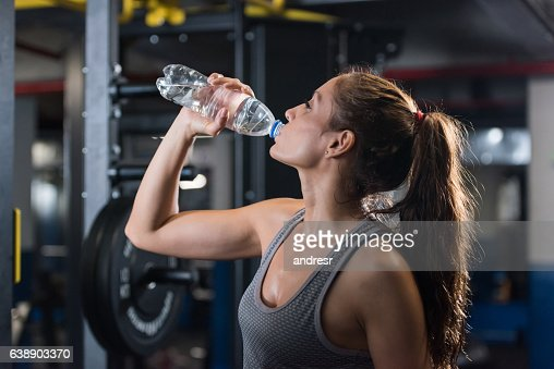 Happy woman at the gym drinking water stock photo getty images keywords sciox Gallery