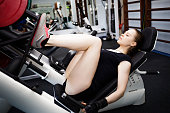Woman at the gym on a sports simulator