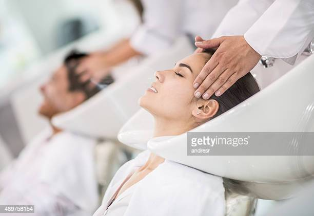 Woman at the hairdresser washing her hair