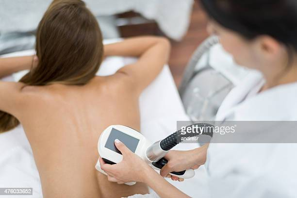 Woman at the spa getting laser therapy