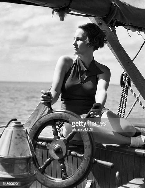 Woman at the stearing wheel of a sailboat 1939 Photographer Cornelius Published by 'Berliner Volkszeitung' Vintage property of ullstein bild