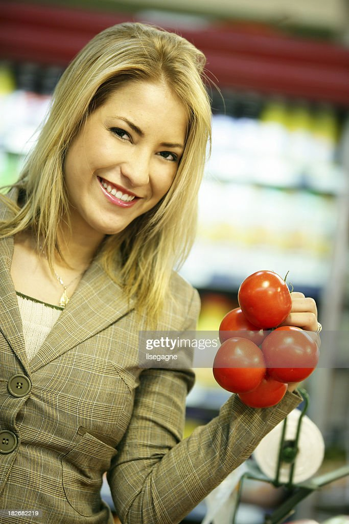 Woman at the supermarket : Stock Photo
