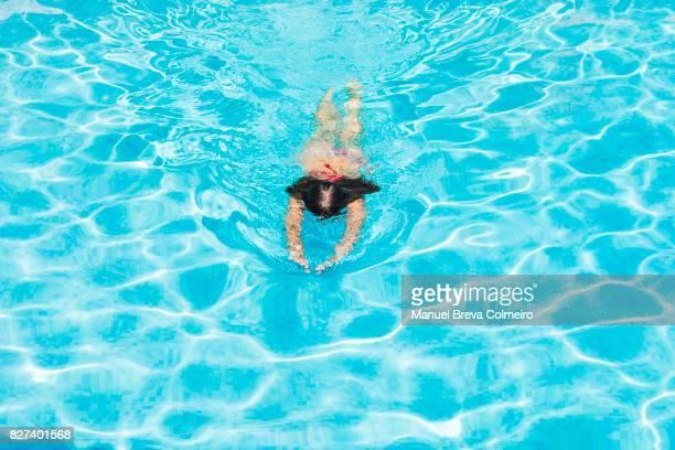 Woman at the swiming pool