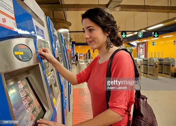 Woman at ticket machine