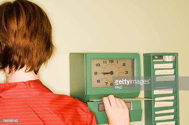 Woman at time clock