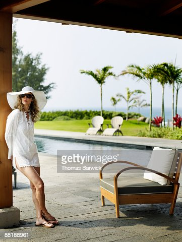 Woman at tropical resort pool in background : Stock Photo