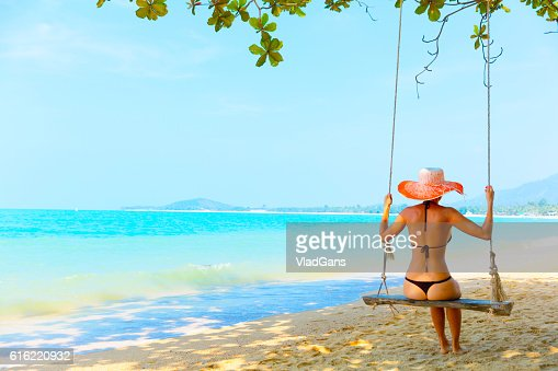 Woman at tropical swing : Stock Photo