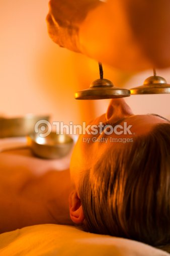 Woman at Wellness massage with singing bowls : Stock Photo