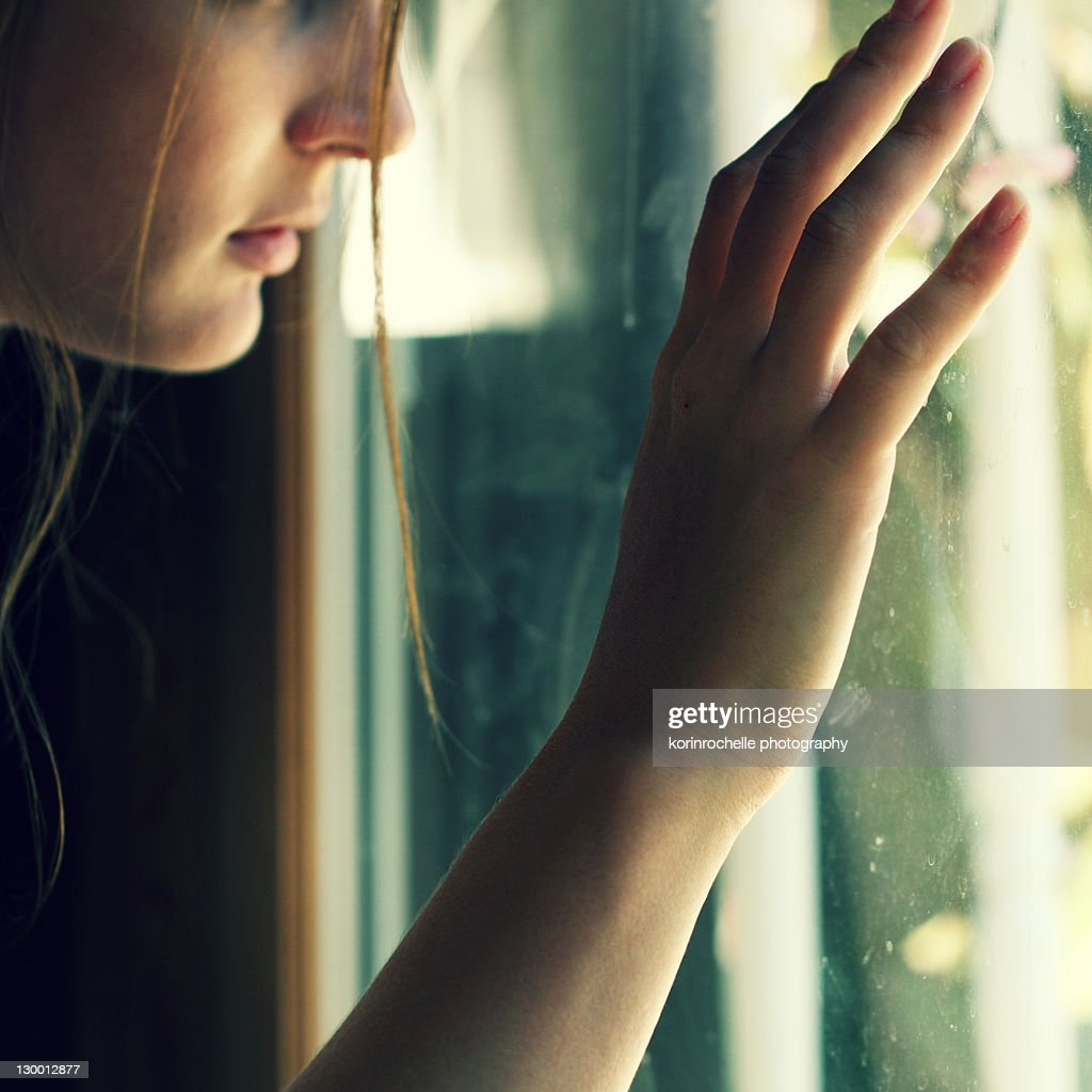 Woman at window : Stock Photo