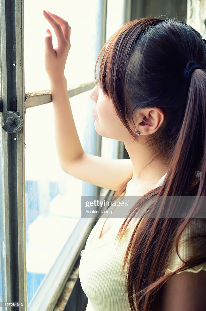 woman at window : Stock Photo