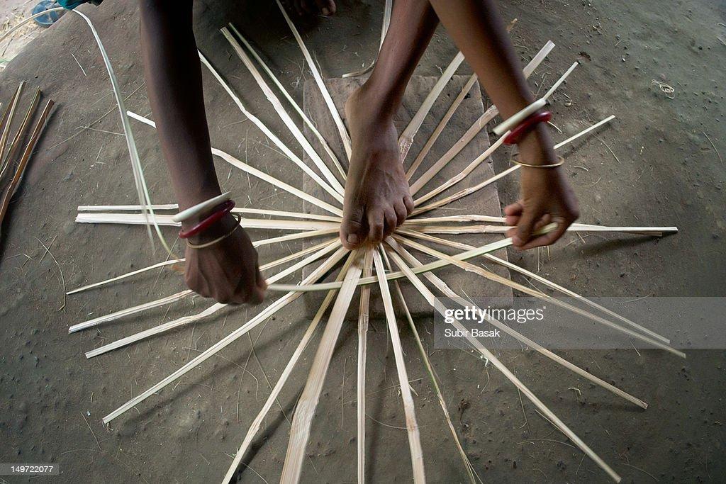 Woman at work,making Basket,West Bengal ,India