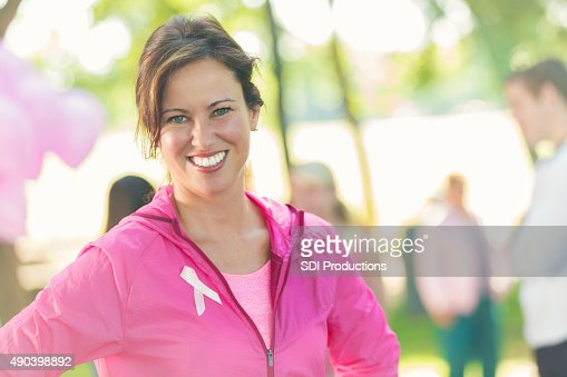 Woman attending 5k charity race for breast cancer research