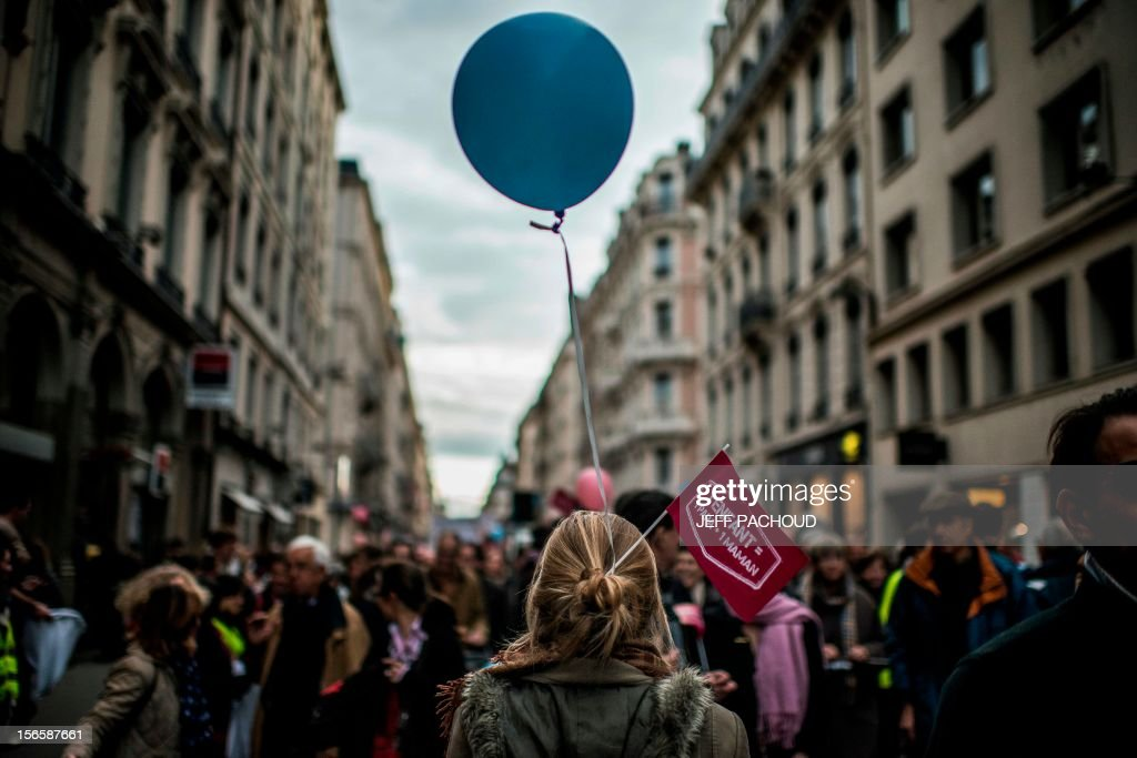 A woman attends a demonstration against the same-sex marriage on November 17, 2012 in Lyon, central eastern France. France's Socialist government on November 7, 2012 adopted a draft law to authorise gay marriage and adoption despite fierce opposition from the Roman Catholic Church and the right-wing opposition. AFP PHOTO / JEFF PACHOUD