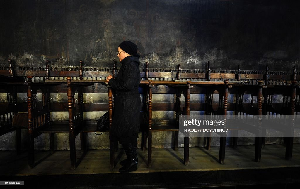 A woman attends a mass in the Presentation of the Blessed Virgin church in Blagoevgrad on February 10, 2013, during a celebration in honour of St. Haralampi, protector of beekeepers.