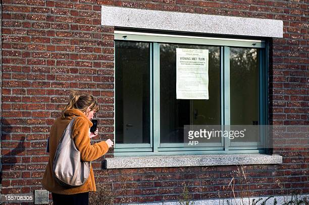 A woman attends a public visit at the house of triple murderer Ronald Janssen on November 7 2012 in Loksbergen in Belgium Janssen has been convicted...