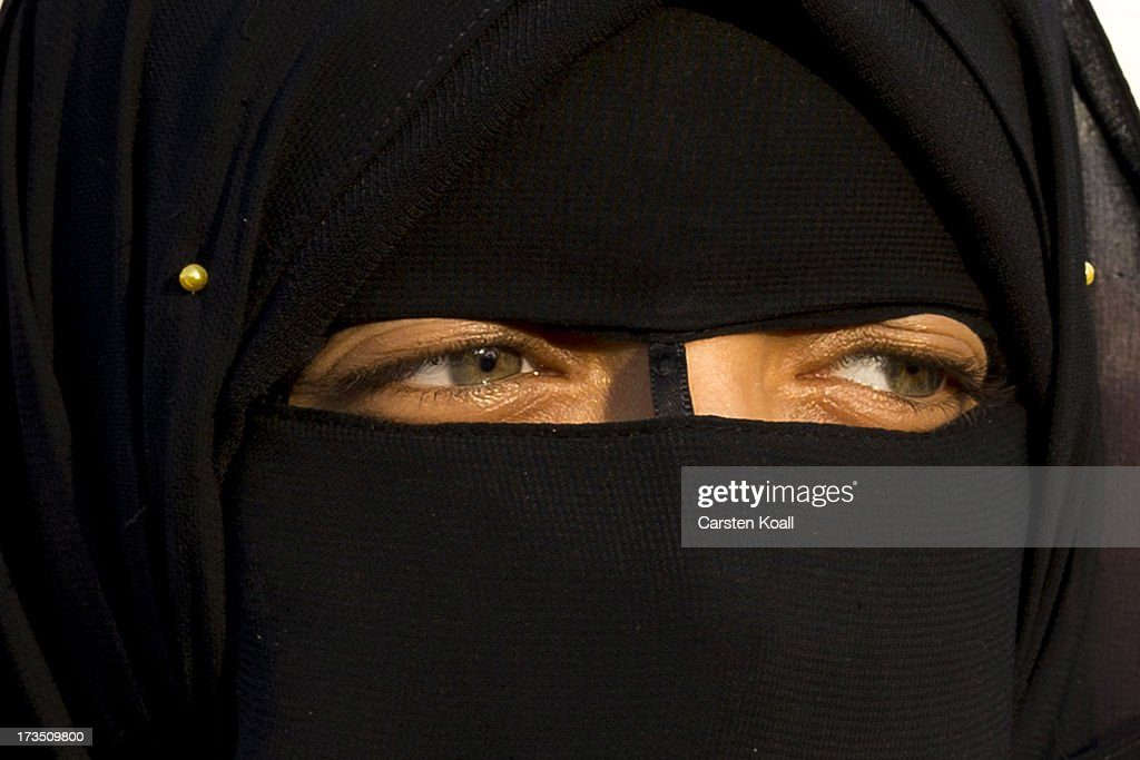 A woman attends a rally as members of the Muslim Brotherhood and supporters of ousted president Mohamed Morsi shout slogans and wave national flags outside Rabaa al-Adawiya mosque on July 15, 2013 in Cairo, Egypt. Senior US official William Burns has arrived in Egypt for the first time since the overthrow of Mohamed Morsi.