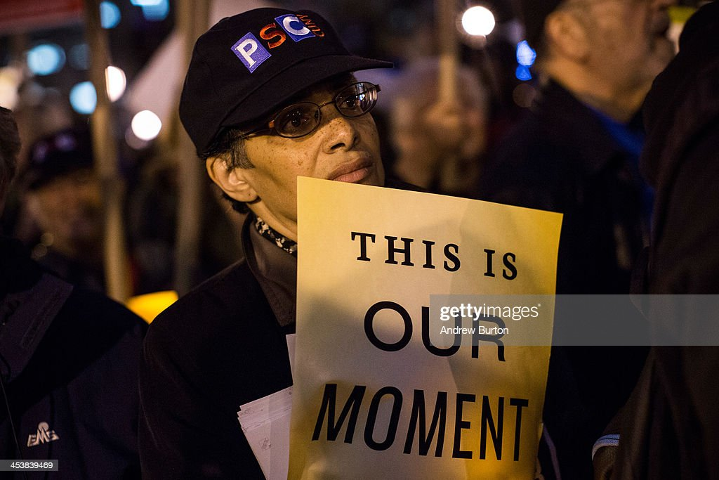 A woman attends a rally calling on greater social equality, organized by non-unionized fast food workers demanding for a wage raise from $7.25 per hour to $15.00 per hour and to be unionized on December 5, 2013 in New York, United States. The day held various protests in front of fast food outlets around the country and culminated in a larger rally attended by various social groups, unions and organizations in downtown Manhattan.