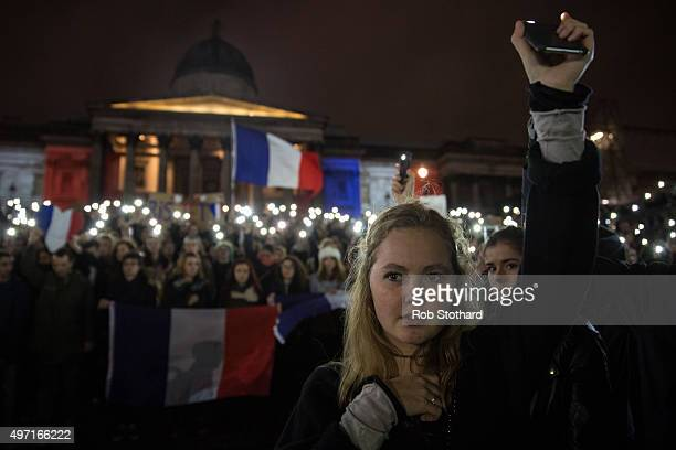 A woman attends a vigil for victims of the Paris terrorist attacks in Trafalgar Square on November 14 2015 in London England Several landmarks across...