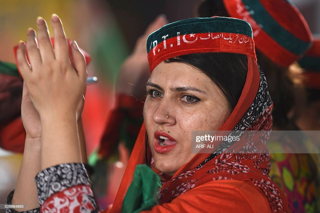 A woman attends an anti-government rally of the opposition party Pakistan Tehreek-e-Insaf (PTI) in Lahore on May 1, 2016, on the Panama Leaks issue. Pakistan's Prime Minister Nawaz Sharif pledged on April 22, 2016 to resign if a probe related to the Panama Papers tax scandal found his family had committed any wrongdoing. Three of Sharif's children were named in a vast leak of documents from Panama-based law firm Mossack Fonseca this month that has revealed how the wealthy hide their money. ALI