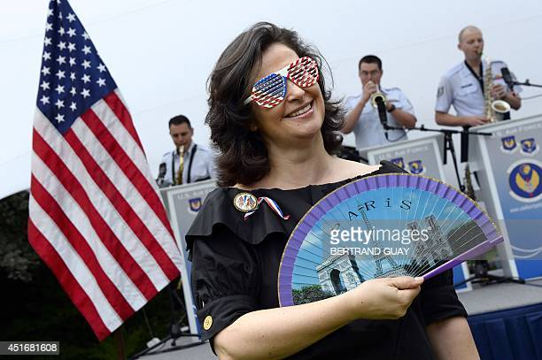 A woman attends Independence Day ceremonies on July 4 2014 at the US embassy in Paris AFP PHOTO / BERTRAND GUAY