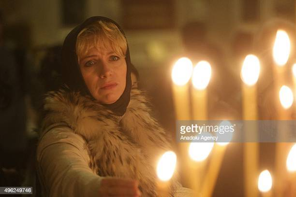 A woman attends memorial service in the memory of Russian airplane crash victims in Egypt at Saint Isaac's Cathedral in St Petersburg Russia on...