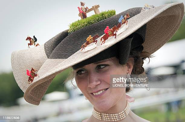 A woman attends the 162nd Prix de Diane horse racing on June 12 2011 in Chantilly north of Paris Golden Lilac can put her name alongisde such turf...