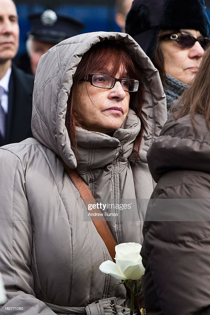 A woman attends the 20th Anniversary Ceremony for the 1993 World Trade Center bombing at Ground Zero on February 26, 2013 in New York City. The attack, which utilized a car bomb and hit the north tower, killed six people.