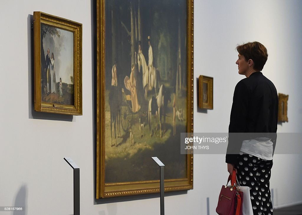 A woman attends the inauguration of the La Boverie museum on May 4, 2016 in Liege. The new museum La Boverie was inaugurated today, with an exhibition organised in partnership with Le Louvre museum. / AFP / JOHN