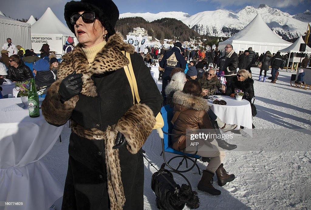 PEDRERO - A woman attends the White Turf horse racing event in St. Moritz on February 3 , 2013. The races are held on the frozen lake of the Swiss mountain resort.