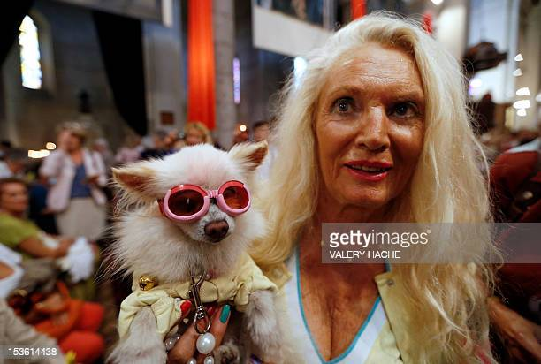 A woman attends with her dog a mass dedicated to animals at the SaintPierred'Arene's church on October 7 in Nice southeastern France AFP PHOTO /...