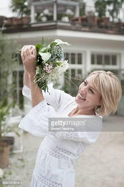 Woman attractive blond catching wedding bouquet