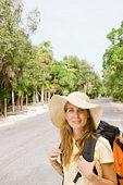 Woman backpacking at tropical resort