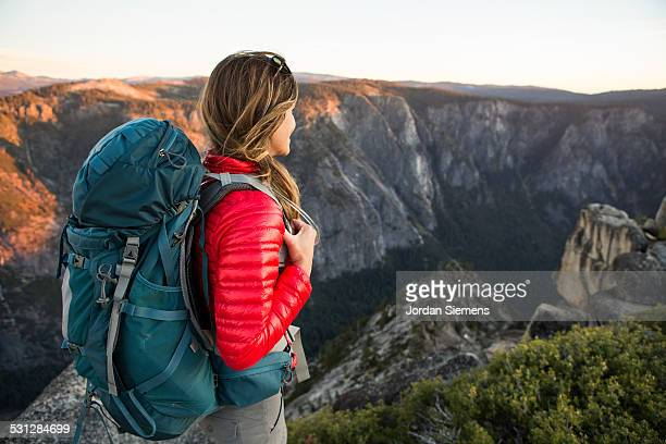 A woman backpacking.