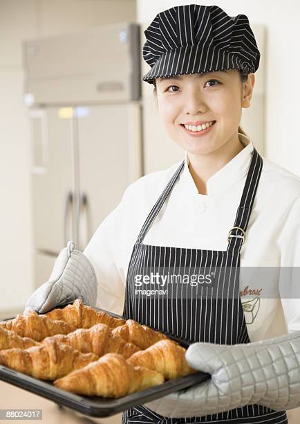 A woman bakery staff