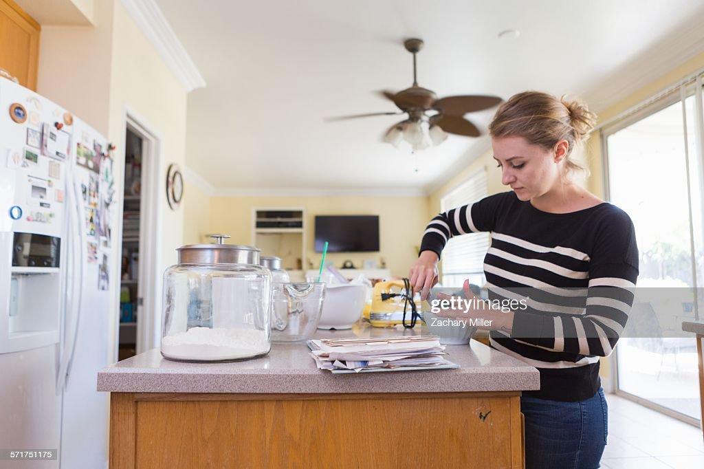Woman baking in kitchen : Stock Photo